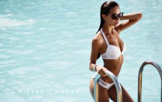 Beautiful woman with sunglasses and a white bikini - Pietro Di Mauro